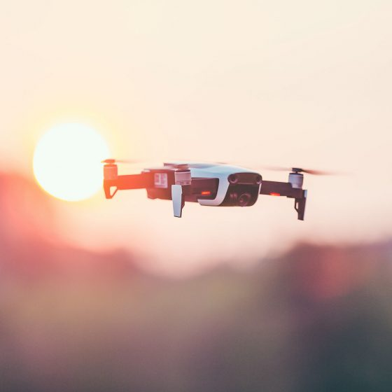 Photo of a small sized drone doing aerial videography and photography